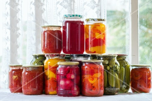 Pickled vegetables in jars on a window sill