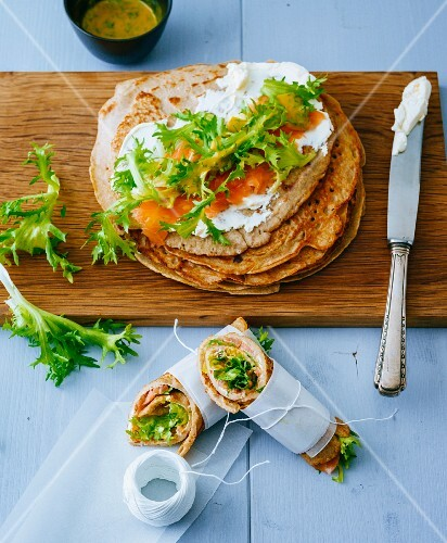 Buckwheat pancakes topped with cream cheese and smoked salmon