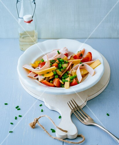 A colourful cheese and ham salad with peas