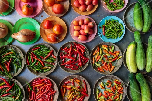 Chilli peppers, tomatoes and cucumbers at a market in Bangkok, Thailand