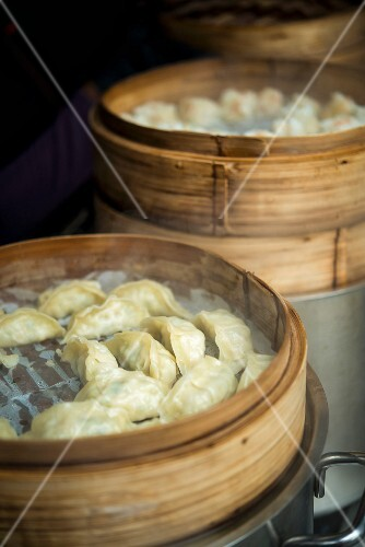 Wontons on rice paper in steamer baskets