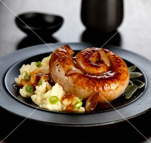 Cumberland sausage with spring onion mashed potatoes and onion gravy