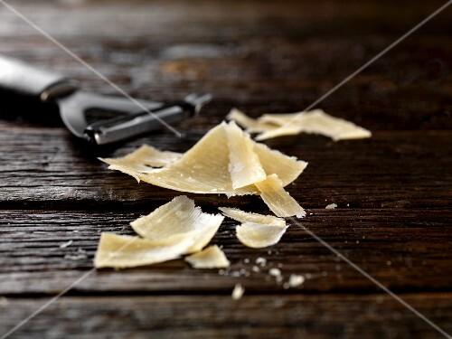 Parmesan shavings on wooden background