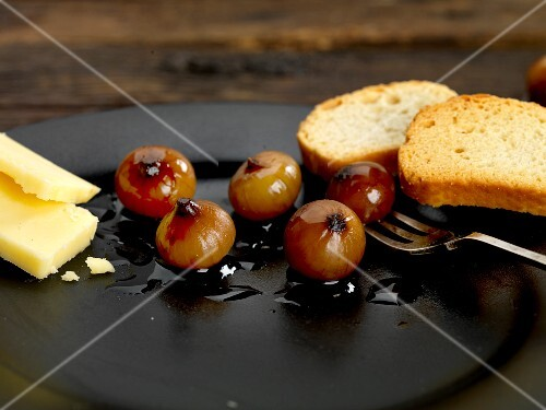 Onions pickled in balsamic vinegar with cheese and bruschetta