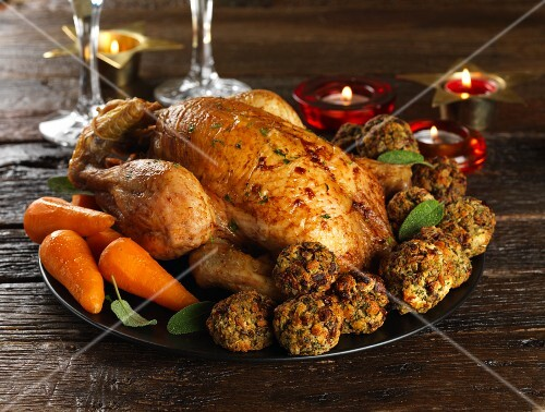 Roast capon with fried bread dumplings and carrots