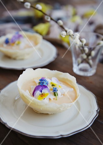 Mango mousse in chocolate bowls