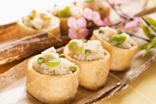 Inari with sticky rice, beans and peas (Japan)