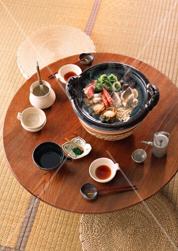 A dining table laid with Yosenabo (Japanese stew prepared at the table)