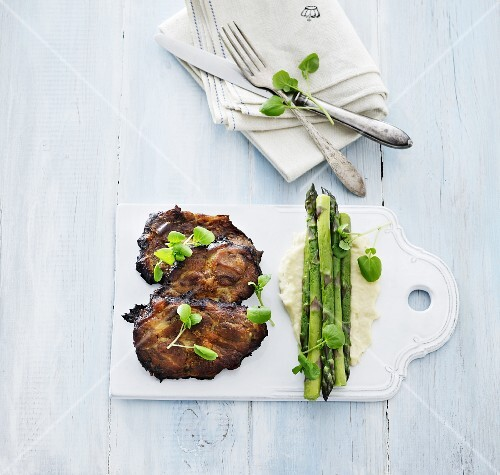 Vegetable and carrot cakes with pine nuts, steamed asparagus and artichoke purée