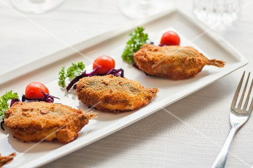 Stuffed and baked anchovies