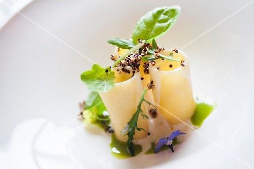 Paccheri with stock fish foam, herbs and black quinoa