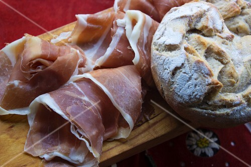 Supper with Vinschgau bread (rye-wheat sour dough) and air-dried country ham on a wooden board