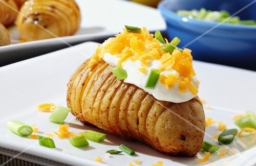 An oven-roasted potato topped with sour cream