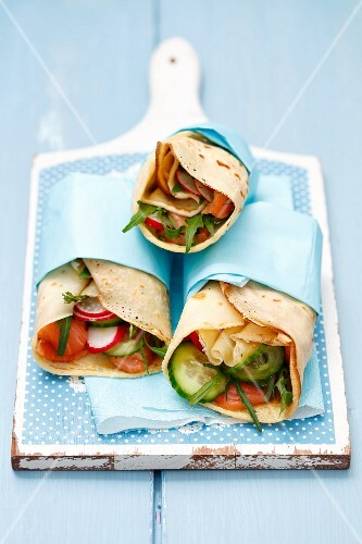 Pancake wraps with smoked salmon, rocket, herbs, cucumber and radishes