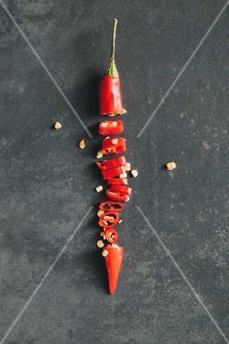 A sliced red chilli pepper (seen from above)