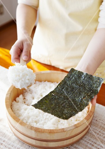 Hand-rolled sushi being made