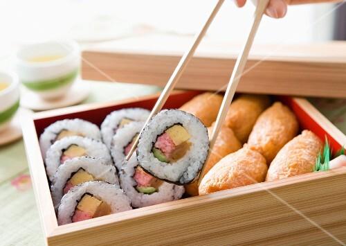 Inari sushi in a wooden box (Japan)
