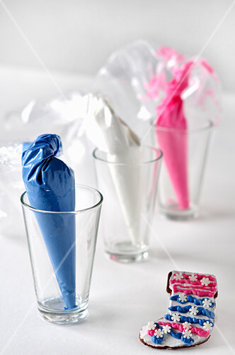 Small cones of sweets in glasses as table decorations