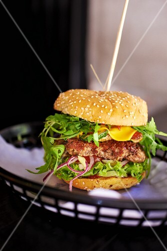 A burger with aubergine and rocket