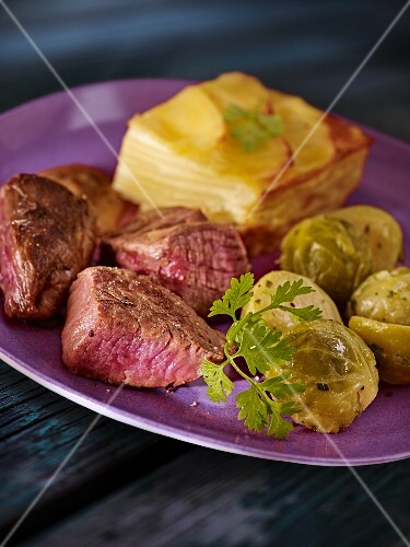 Beefsteak with Brussels sprouts and potato gratin