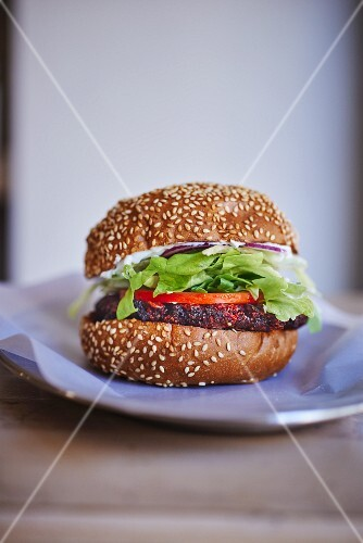 A veggie burger with a beetroot patty