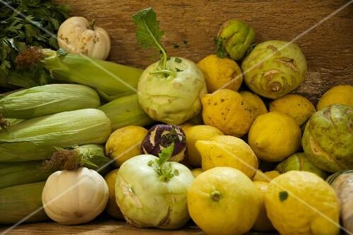 Fresh kohlrabi, lemons, squash and corn cobs