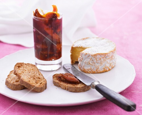 Plum confit with oranges served with grilled bread and soft cheese