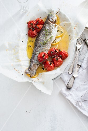 Baked trout with cherry tomatoes and lemon