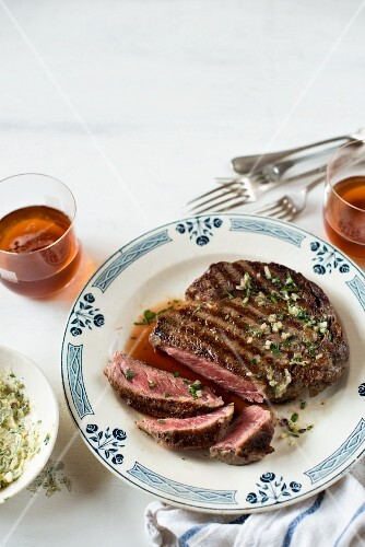 Grilled beef steak with herb butter