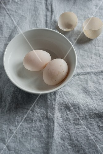 Two duck eggs in a bowl