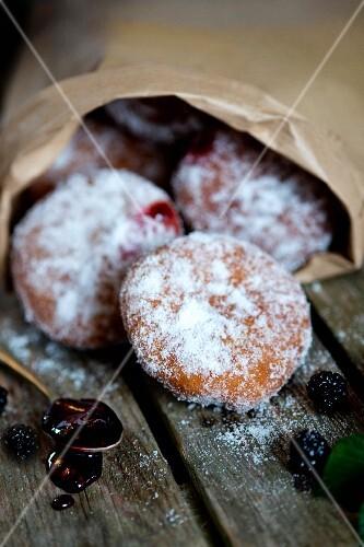 Blackberry doughnuts in a paper bag