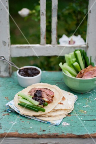 Peking duck (fried duck breast served with pancakes, cucumber, spring onions and plum sauce)