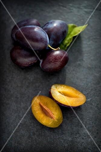 Fresh plums on a slate platter