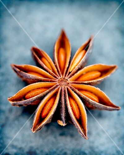 An anise star on a blue slate surface