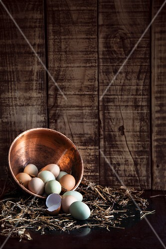 Free range eggs in copper bowl on straw