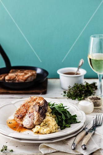 Fried pork chop with quince glaze and mashed celeriac
