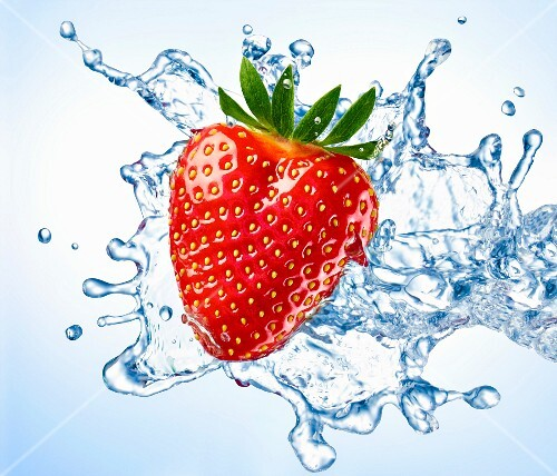 A strawberry with a splash of water (close-up)