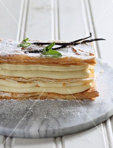 A puff pastry slice with vanilla cream
