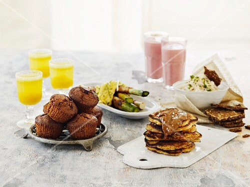 A brunch buffet with drinks and savoury and sweet dishes