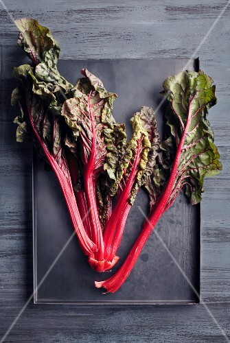 Red-stemmed chard on a baking tray