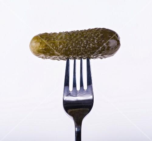 A gherkin on a fork