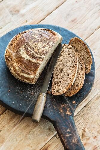 Bread, sliced, on a wooden board