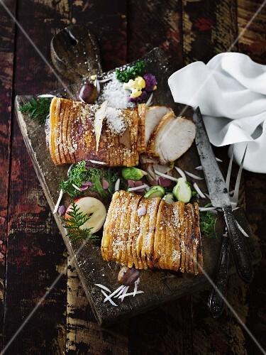 Winter roast pork on a wooden board (seen from above)