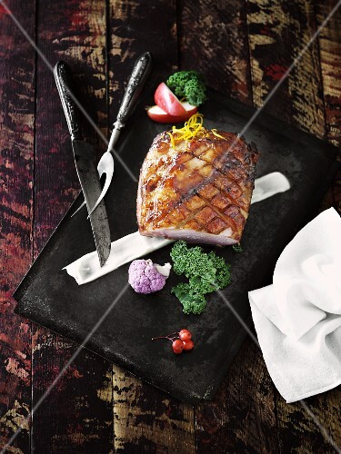 Crispy roast pork on a baking tray