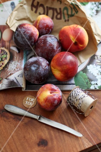 Nectarines and plums on a wooden table