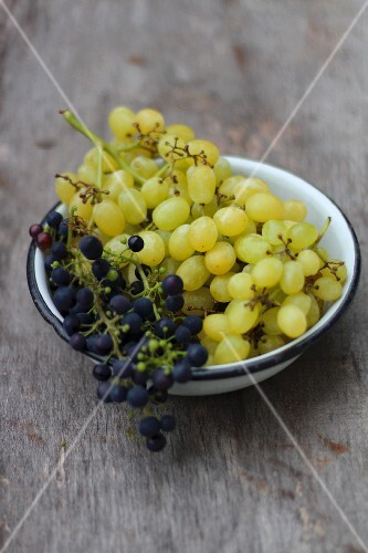 Grapes in an enamel bowl