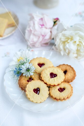 Jam sandwich biscuits served with tea