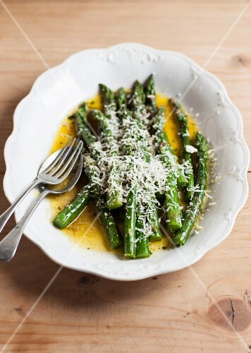 Green asparagus in liquid butter with Parmesan cheese