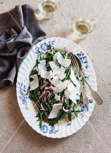 Green bean salad with red onions and shaved Parmesan cheese