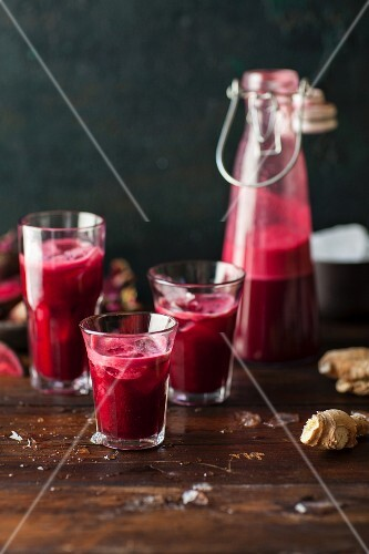 Beetroot juice in a bottles and glasses